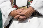 Hands of a man in folklore costume